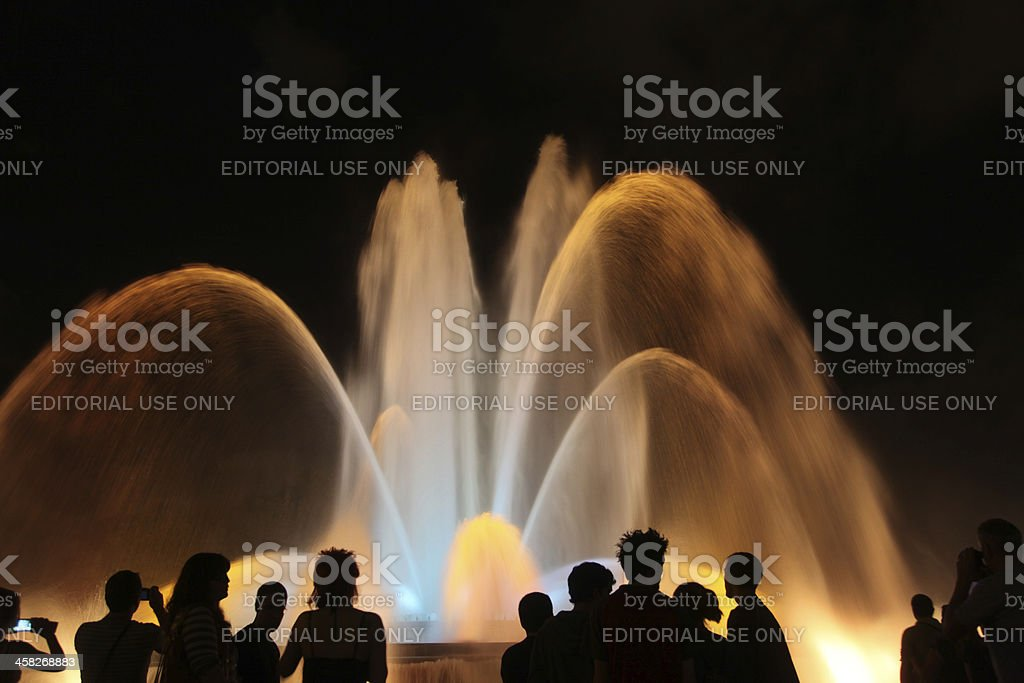 Young people watching Magic Fountain in Barcelona royalty-free stock photo