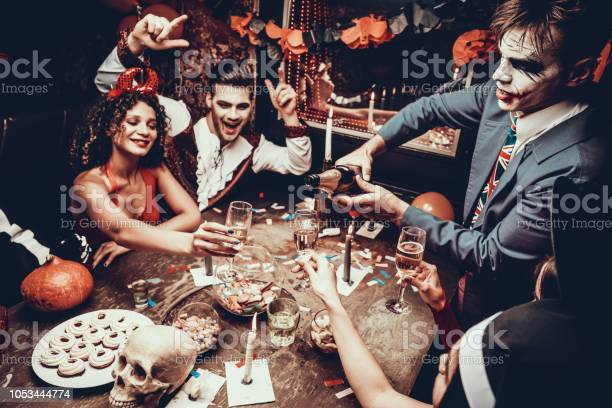 Young people wearing costumes drinking champagne picture id1053444774?b=1&k=6&m=1053444774&s=612x612&h=f41ukavqr9alov5wqk9hhml2znf0lomqrbu5sayp5w8=