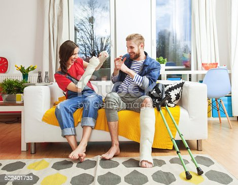 istock Young people with broken leg and arms 522401733