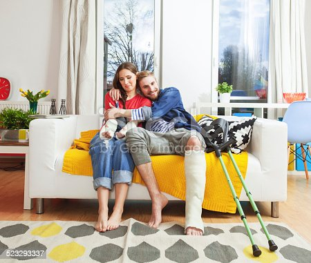 istock Young people with broken leg and arms 523293337