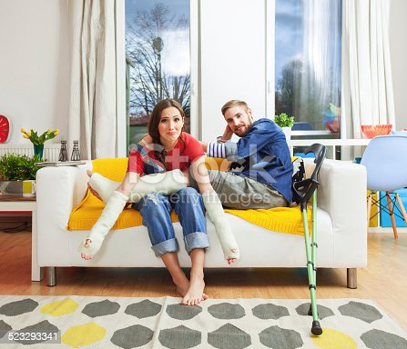 istock Young people with broken leg and arms 523293341