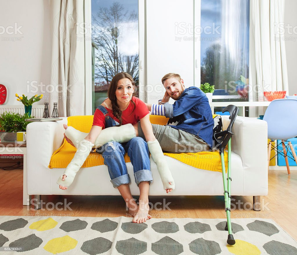 Young people with broken leg and arms stock photo