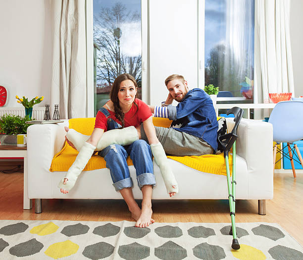 young people with broken leg and arms - broken leg stock photos and pictures