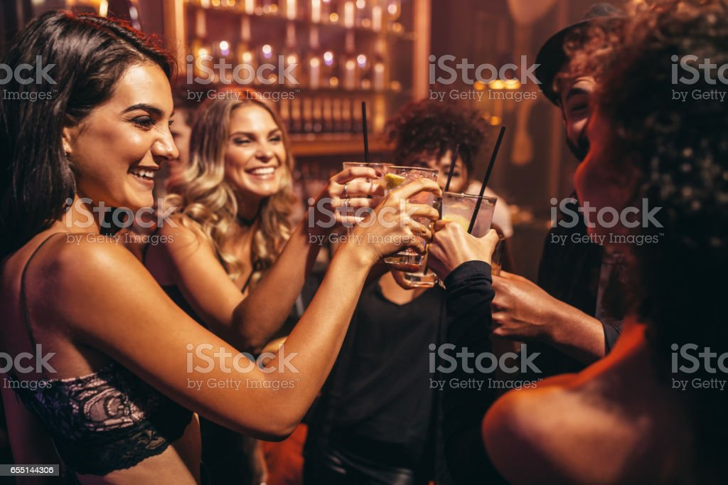 Young people with cocktails at nightclub stock photo