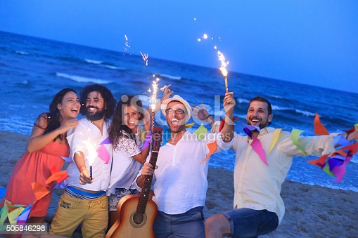 471113366istockphoto Young people with fireworks on the beach 505846298