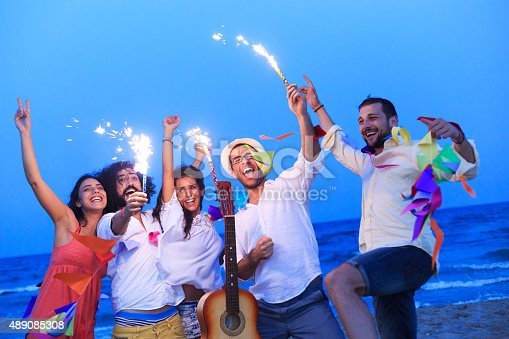 471113366istockphoto Young people with fireworks 489085308