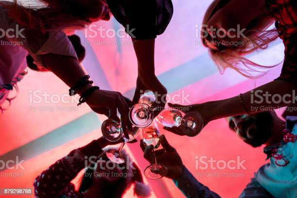 Young people with glasses of champagne at christmas party picture id879298768?b=1&k=6&m=879298768&s=612x612&h=u z8znz zyx4rt7xodvfze3k6vdumn8bkwpkntnjmvq=