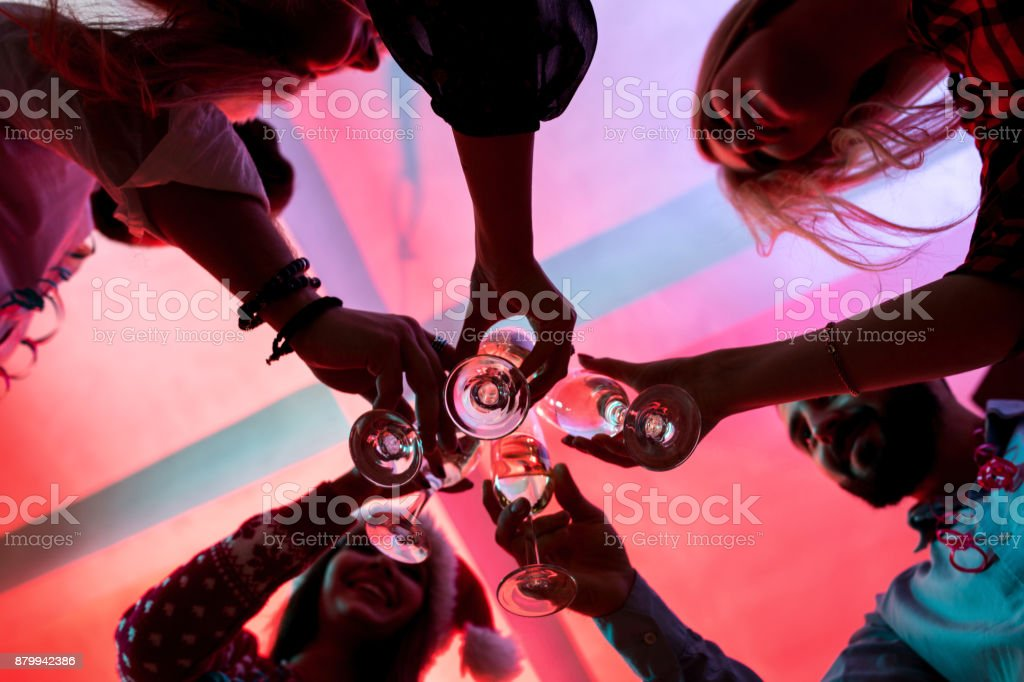 Young people with glasses of champagne at Christmas party stock photo