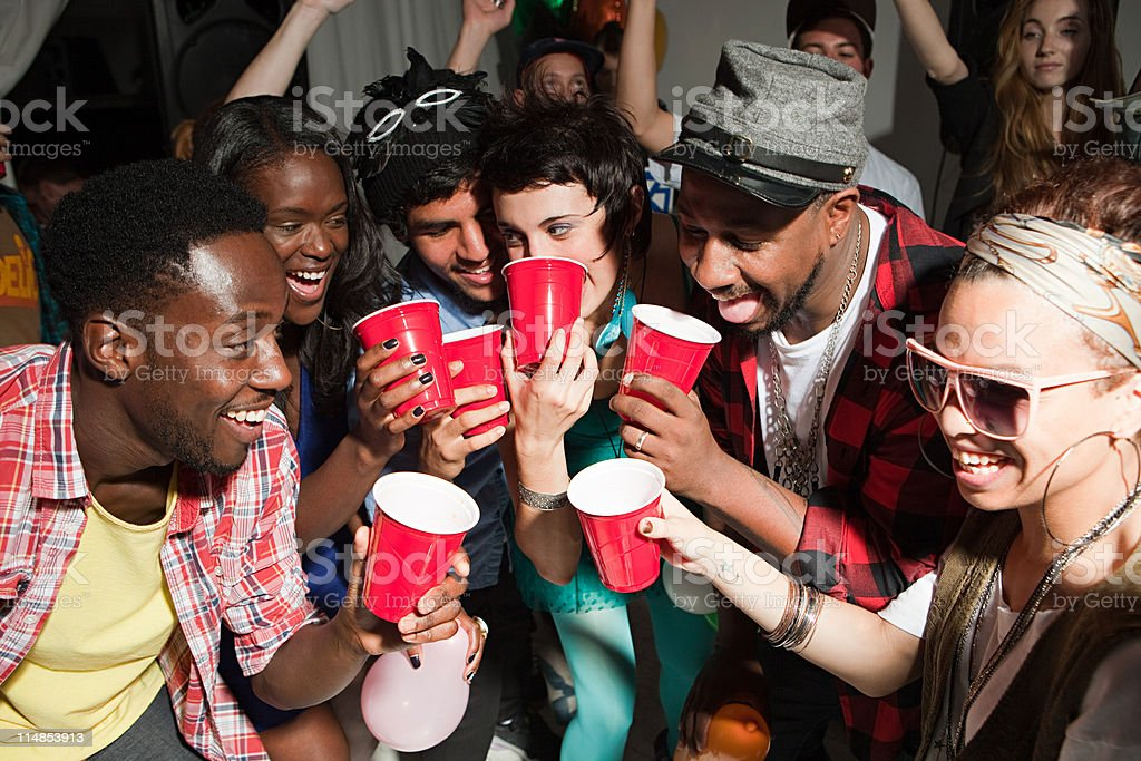 Young people with plastic cups at party stock photo