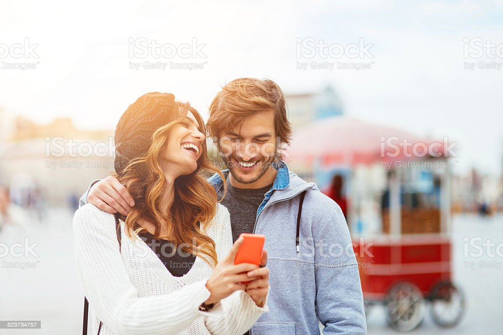 Young People with smart phone on the street stock photo