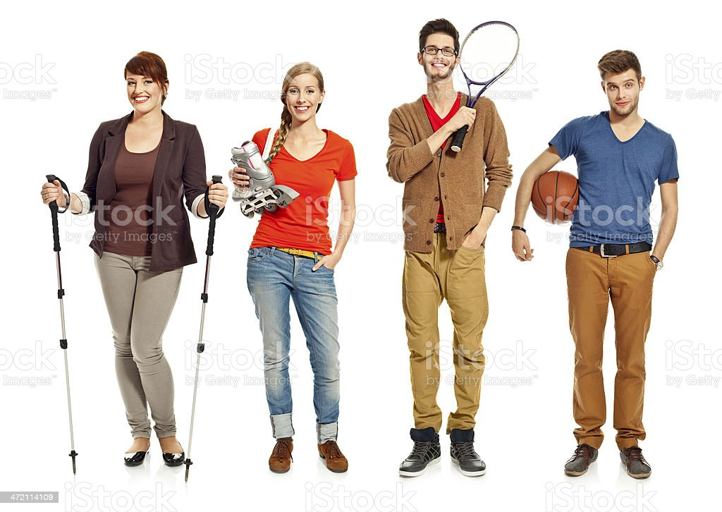 Young people with sport equipments Four happy young adults standing in a row and holding in hands diverse sport equipments. Studio shot, white background. 18-19 Years Stock Photo