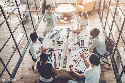 istock Young people work in modern office. 881484328