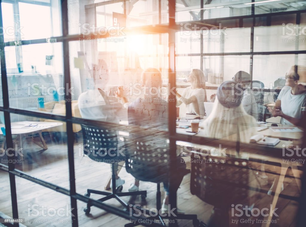 Young people work in modern office. stock photo
