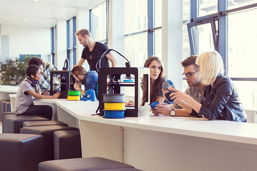 Young People Working In 3d Printer Office Stock Photo - Download Image Now