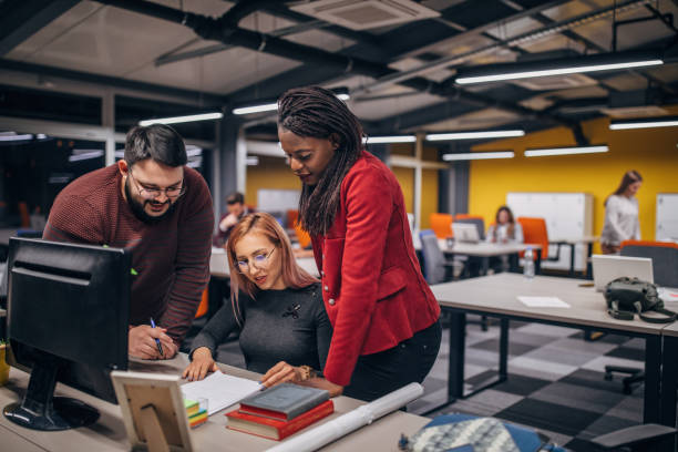Young people working in modern office stock photo