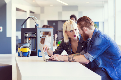 Young People Working On Laptop In 3d Printer Office Stock Photo - Download Image Now