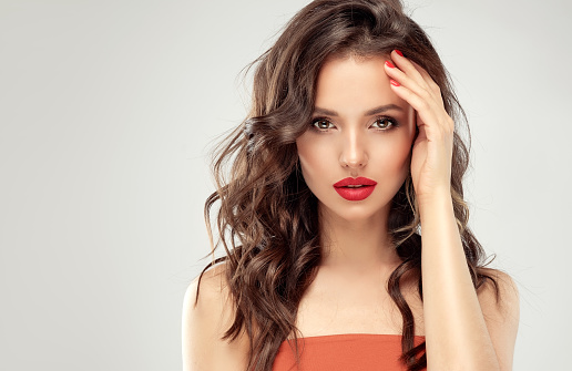 istock Young, perfect woman is looking straight on viewer.  Cosmetology, hairdressing and makeup. 1163416046