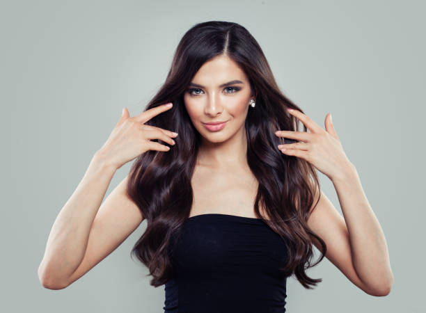young perfect woman with long hairstyle. beautiful hair woman - capelli castani foto e immagini stock