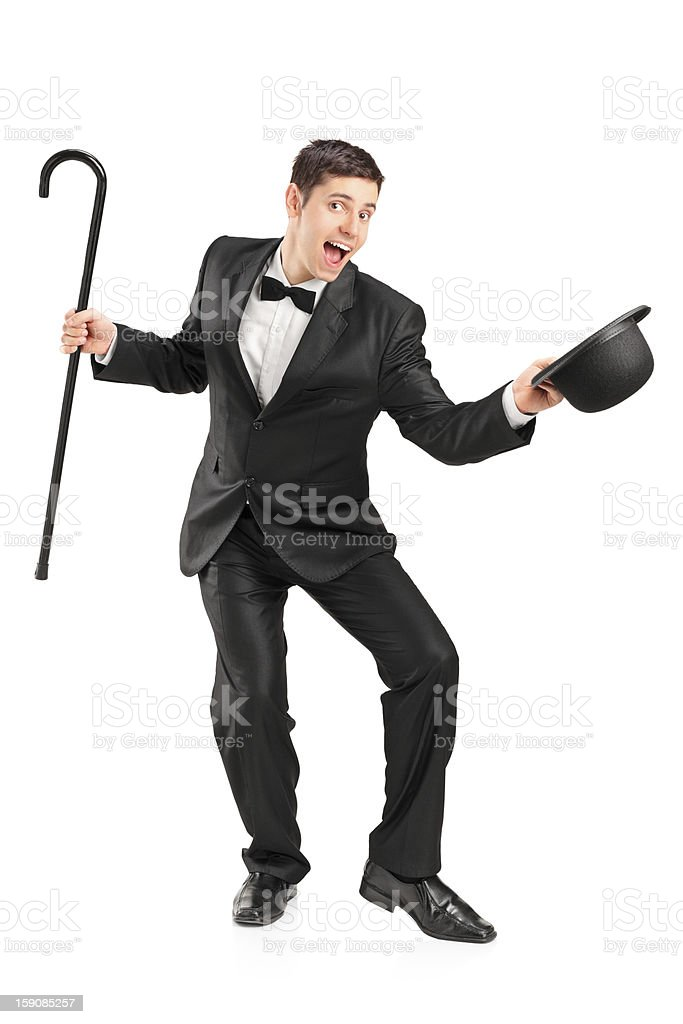 Young performer with cane and hat gesturing stock photo