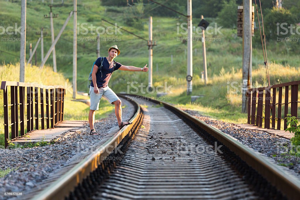 Young Person catching Train on Countryside Railroad Bridge stock photo