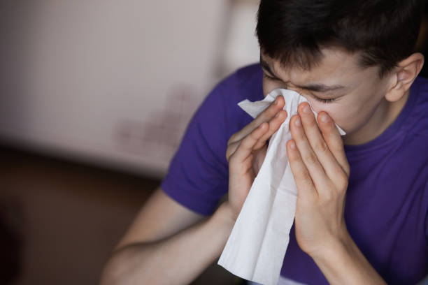 Young person have a problem with allergies People in a process of healing. Allergies problem.  Very Shallow DOF. Developed from RAW; retouched with special care and attention; Small amount of grain added for best final impression. antihistamine stock pictures, royalty-free photos & images