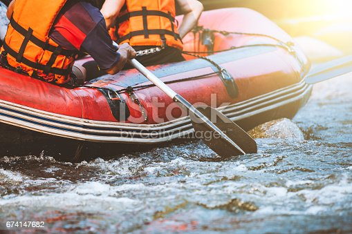 istock Young person rafting on the river, extreme and fun sport at tourist attraction 674147682