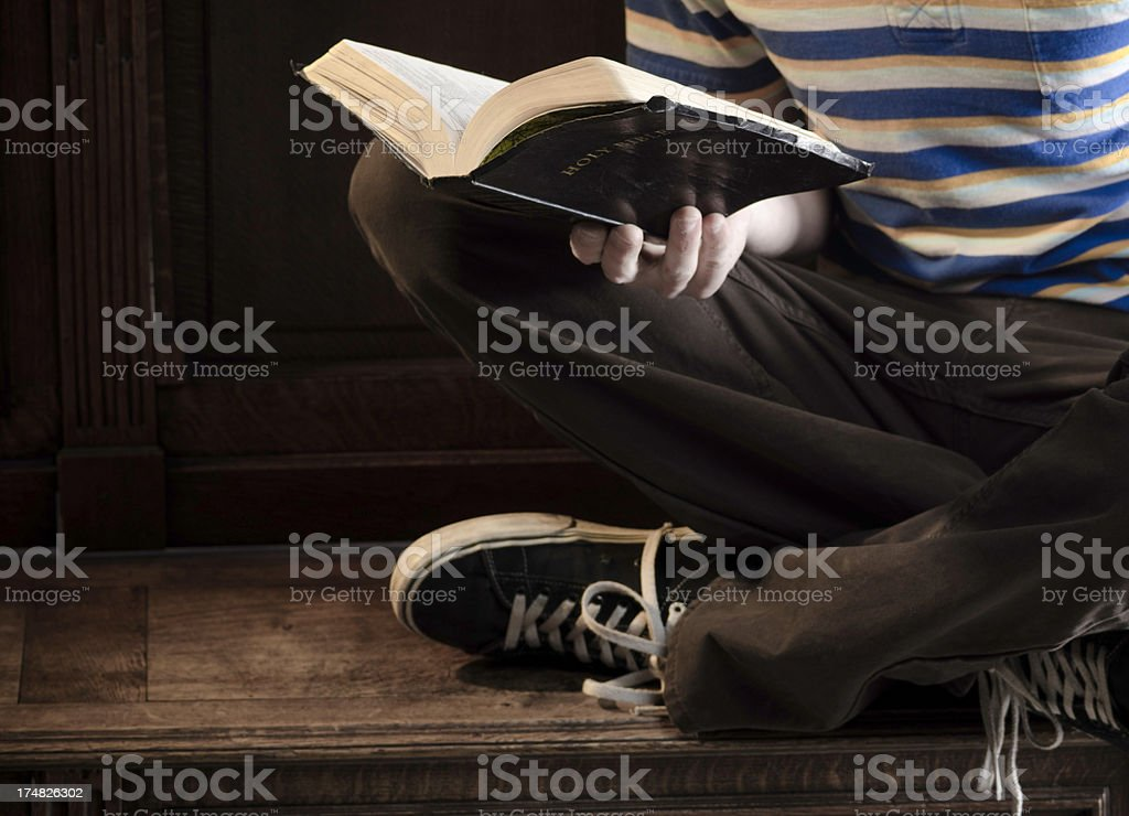 Young Person Reading the Bible stock photo