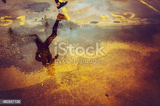 istock Young person running over the parking lot 492537100