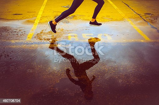 istock Young person running over the parking lot 492708704