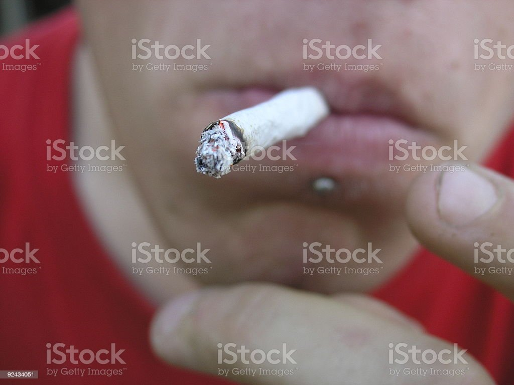 Young person smoking stock photo
