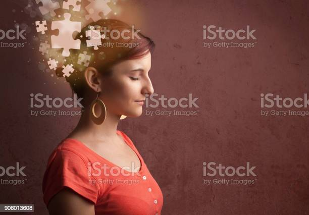 Young person thinking with glowing puzzle mind picture id906013608?b=1&k=6&m=906013608&s=612x612&h=shpfh8i18kdsnembxksamht ge4emywm3t1bv4an3is=