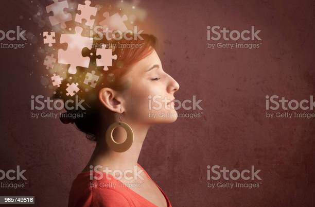 Young person thinking with glowing puzzle mind picture id985749816?b=1&k=6&m=985749816&s=612x612&h=rrtv vf6kj6wif1nfzgnjd9d6iknp5tjq09m3ro4bg0=