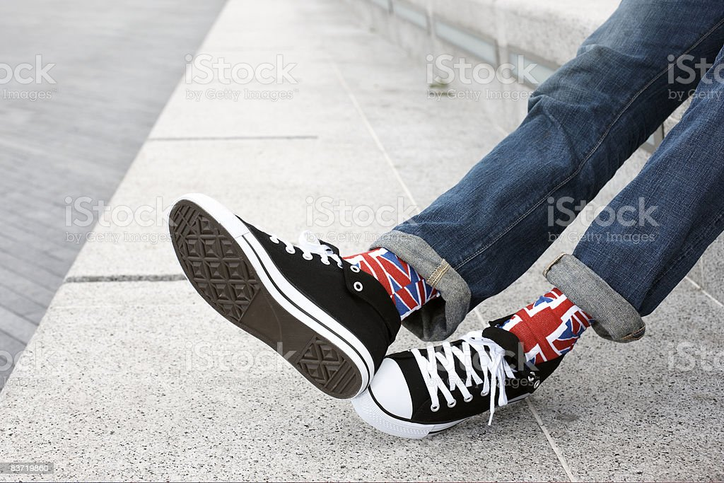 Young person wearing Union Jack socks royalty-free stock photo