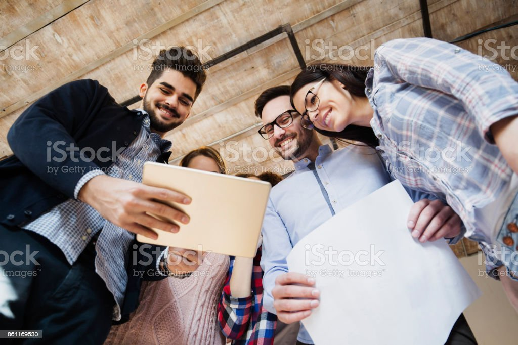 Young perspective designers looking at project schemes royalty-free stock photo