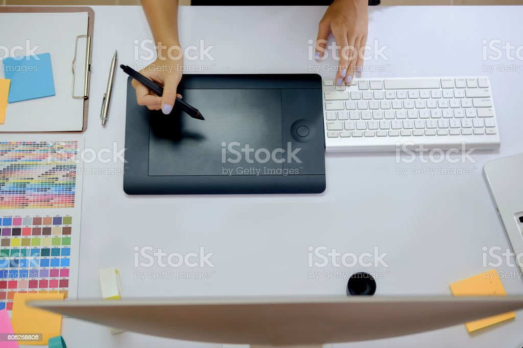 Young photographer and graphic designer at work in office. stock photo
