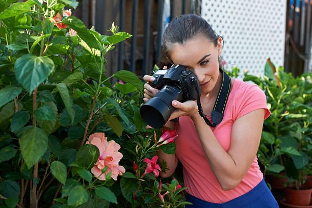 Young Photographer In Garden stock photo