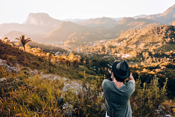 Young photographer outdoors Young photographer outdoors digital single lens reflex camera stock pictures, royalty-free photos & images