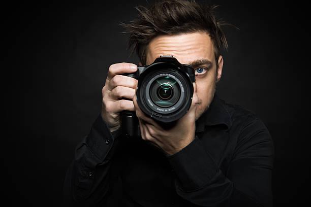 young photographer - telelens stockfoto's en -beelden