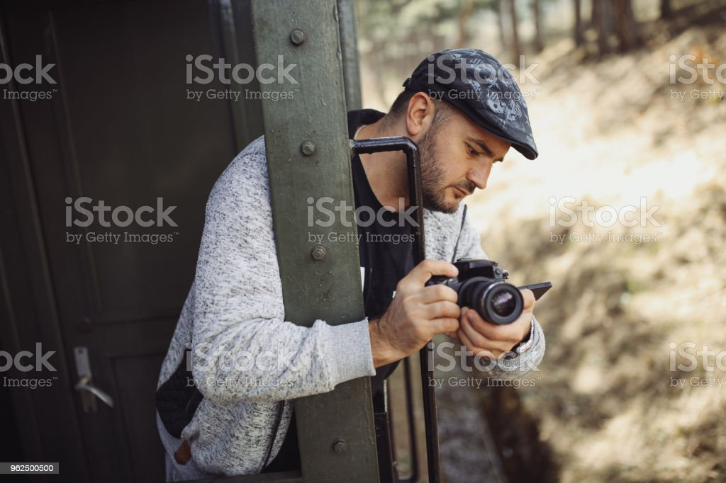 Young photographer traveling by train - Royalty-free Adult Stock Photo