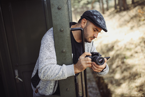 Young Photographer Traveling By Train Stock Photo - Download Image Now