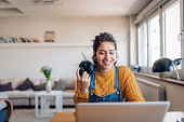 istock Young photographer working on her photos at her home office 1265249318