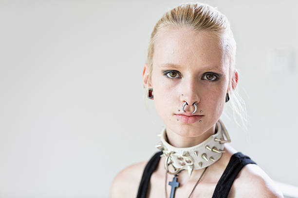 young pierced woman portrait - nose ring stock photos and pictures