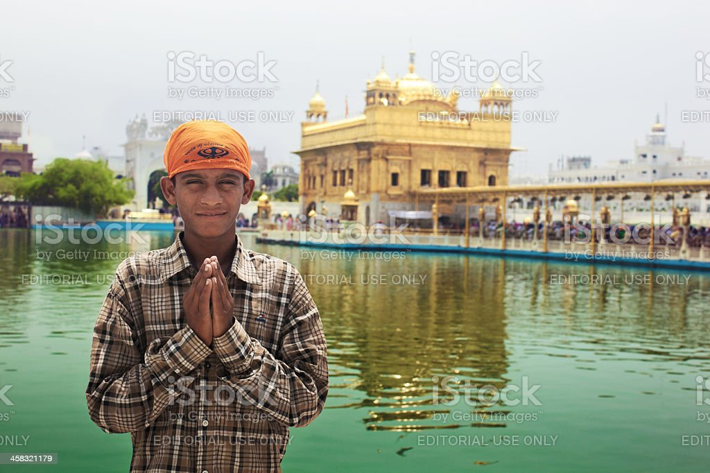 Young pilgrim in Golden Temple stock photo