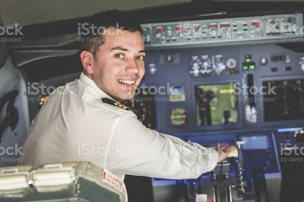 Young Pilot in the Airplane Cockpit stock photo