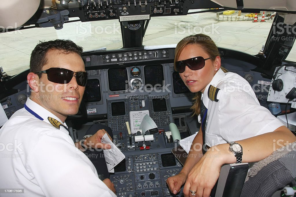 Young pilots flaying in cockpit of commercial jet royalty-free stock photo