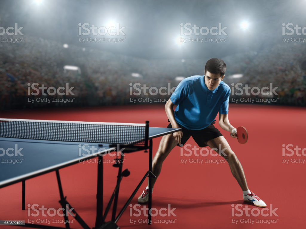 Young ping pong player playing table tennis game stock photo