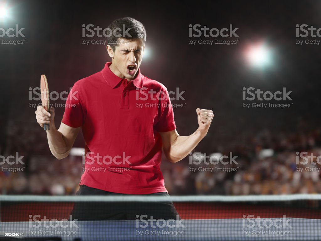 Young ping pong player rejoices in his victory royalty-free stock photo