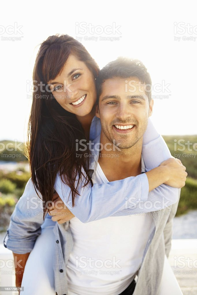 Young, playful couple spending time together royalty-free stock photo