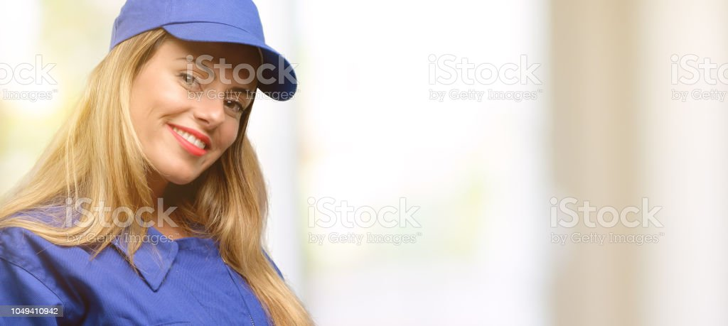 Young plumber woman confident and happy with a big natural smile...