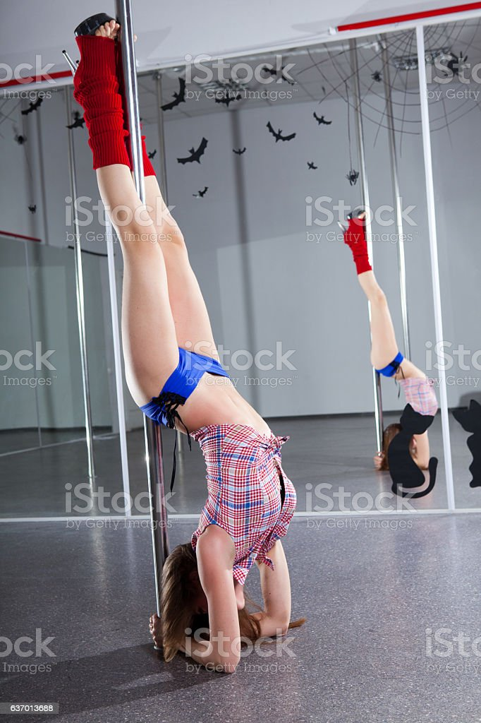 young pole dancer stock photo